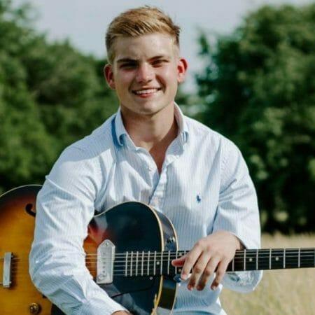 Braden Jamison with guitar