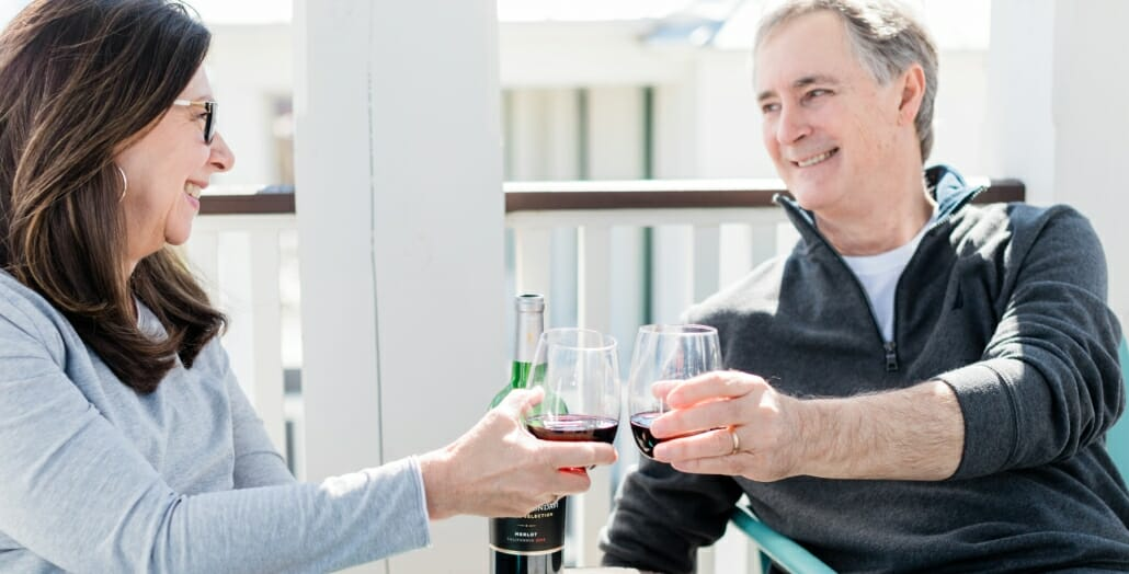 couple enjoying a glass of wine at their vacation home at Carlton Landing OK
