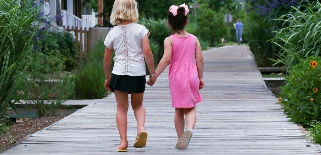 kids walking on the boardwalk