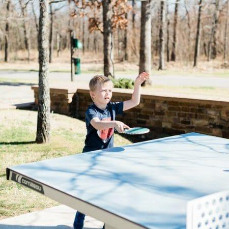 Child playing ping pong