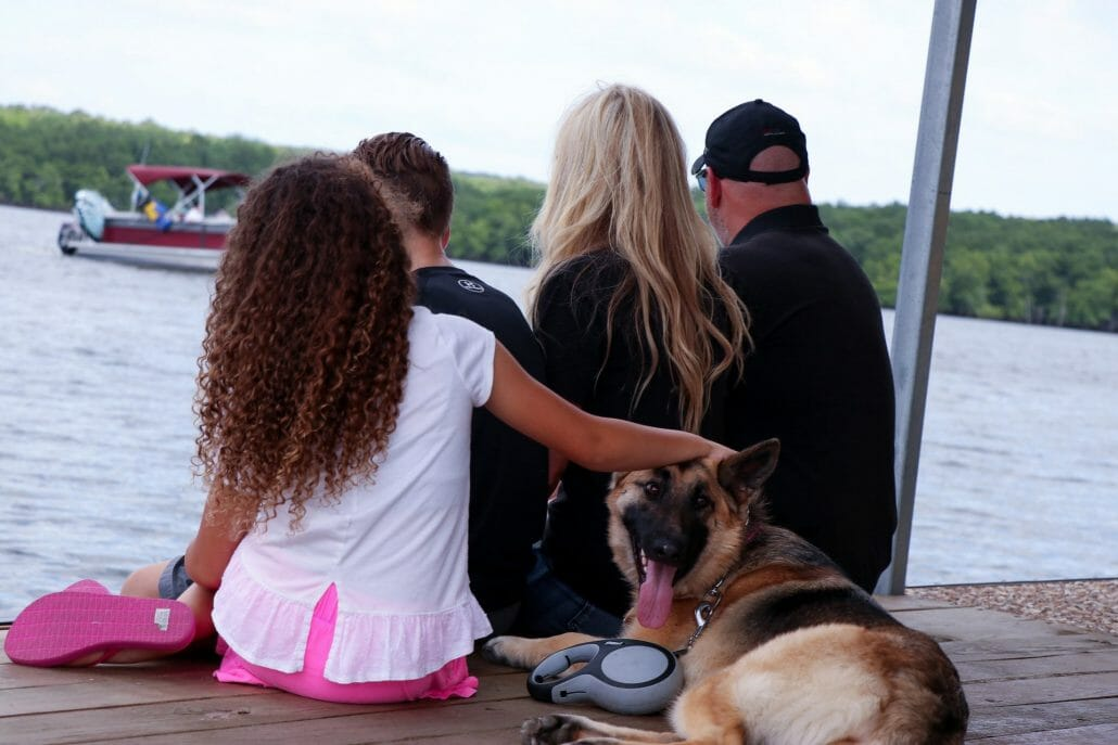 Family sitting on the dock